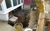 view large image of refurbishment work being carried out next to pavement without segregation