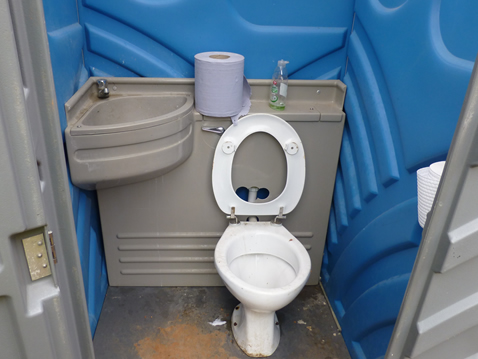 Basic but effective sanitation facilities in place for site workers consisting of hand washing basin and toilet.