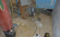 view large image of unsafe electrical power supply where site management fell below safe standards