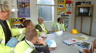 A group of workers viewing a health and safety video