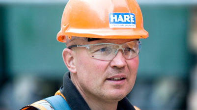 Construction worker in hardhat and protective eyewear